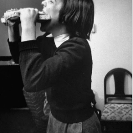 "Teenager eating a ""submarine"" sandwich at a party.1954, Life Magazine,1937"
