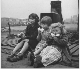 Berenice Abbott. Children in blitzed north of England eating meal from bread and Lease Lend cheese.1940, Life